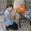 Gracie carving pumpkins