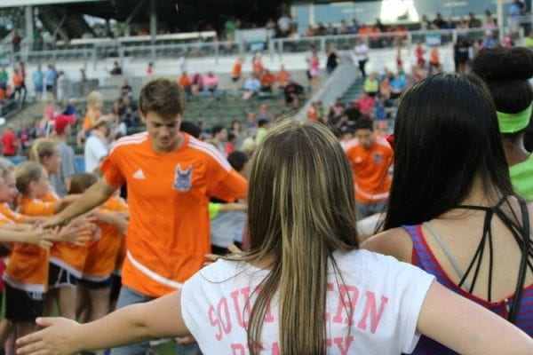 Fan tunnel Jeremy slapping hands Carolina Railhawks