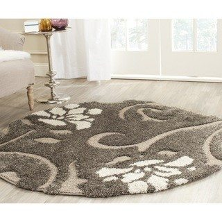 Over $100 round rugs
